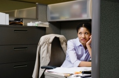 Woman-Sitting-Down-at-Work